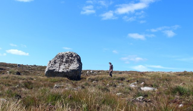 An erratic boulder lies where it was abandoned by melting ice 10,000 years ago