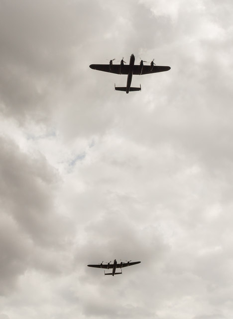 Two Avro Lancasters fly over Strubby Airfield