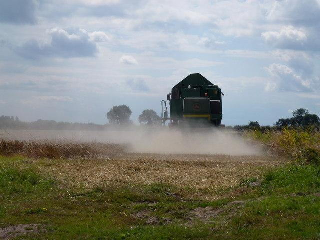 John Deere combine in the dust
