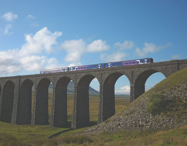 Passenger train crossing the Ribblehead Viaduct