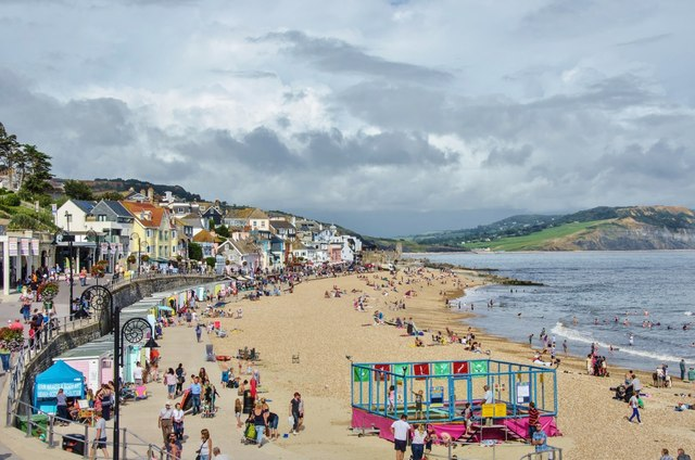 Lyme Regis: Fun on the beach trampolines