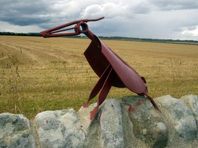 Sculpture on a wall to the north of Boulmer