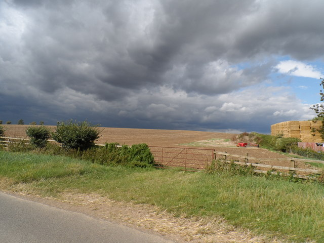 Harvested field and threatening sky