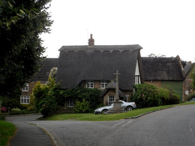 Thatched cottage and war memorial, Newnham
