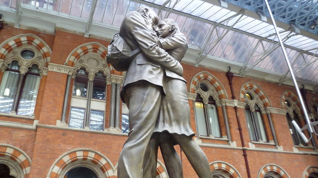 The Meeting Place statue in side St Pancras International railway station