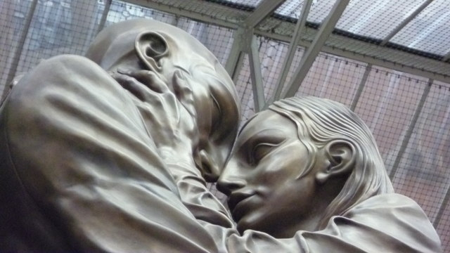 Close-up of 'The Meeting Place' statue in St Pancras International