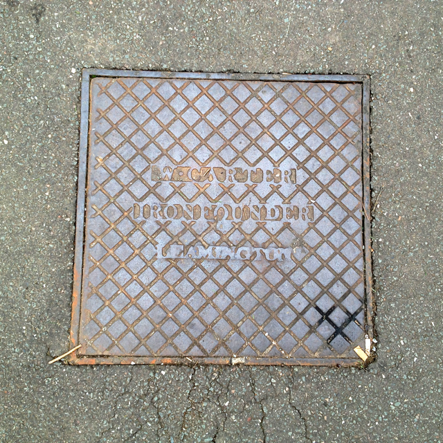 Cast iron inspection cover, Pump Room Gardens, Royal Leamington Spa