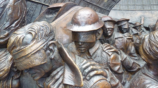 Detail on the 'Meeting Place' statue in St Pancras International railway station, London
