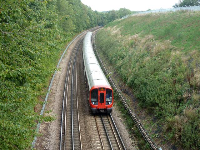 Metropolitan Line train approaching bridge MR103