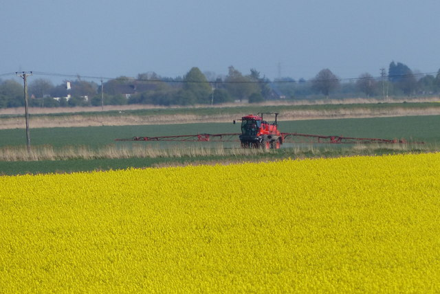 Spraying the crops near the River Glen