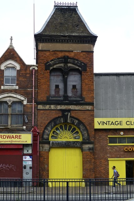 Old warehouse tower with bright yellow door and fanlight