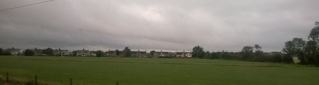 Houses on Glinton Road, Helpston, from a train speeding north