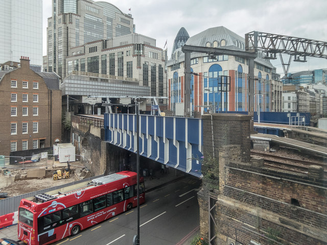 Bus passing under Bridge over the Minories as seen from Tower Gateway Station, London E1