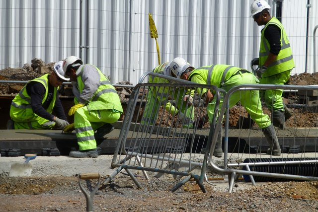NET workers smoothing concrete
