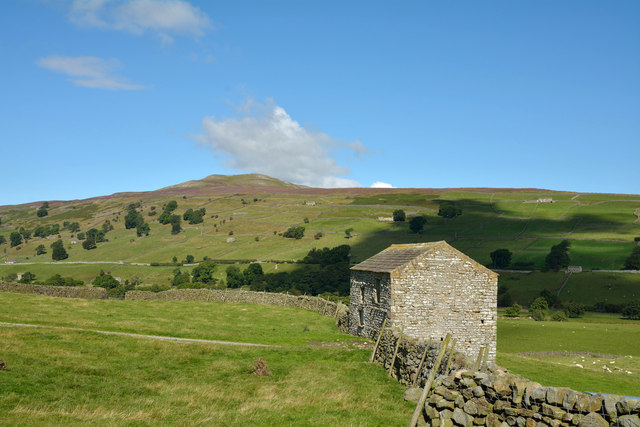 Barn inset into dry stone wall
