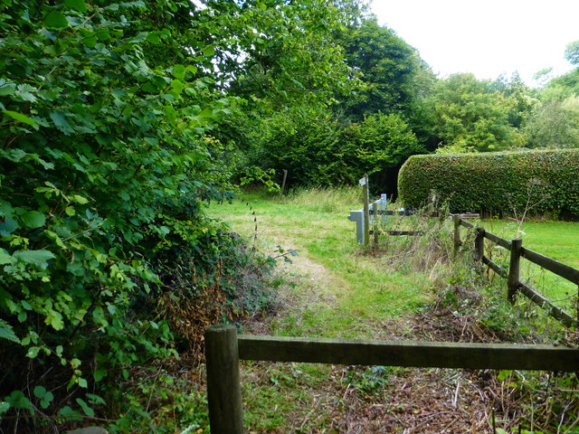 Footpath reaches junction of bridleways and byway near Closedown House