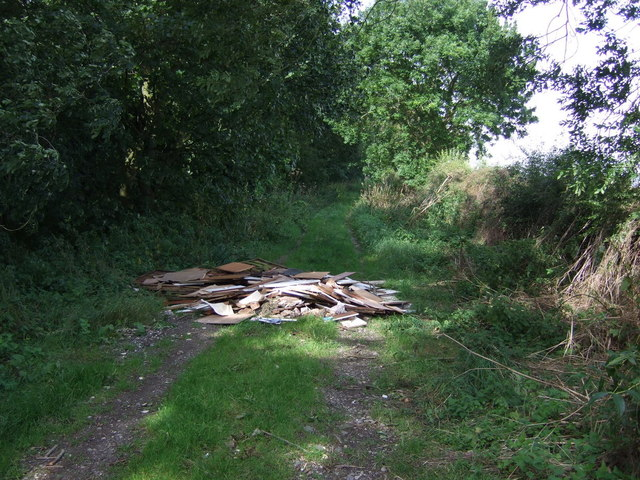 Fly tipping on track beside Fox Covert Plantation