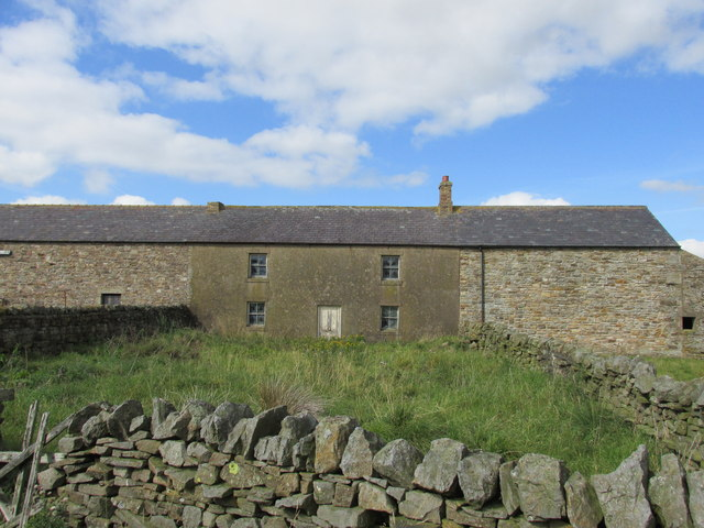 House sandwiched between barns at North doubledyke.