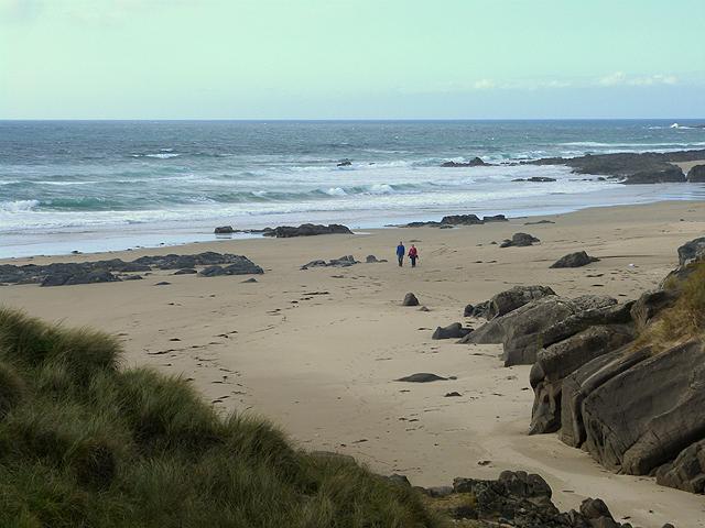 Walker on the beach at Saligo Bay
