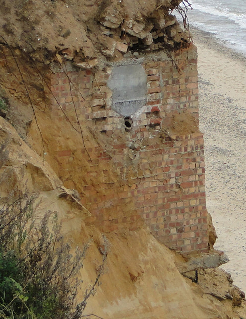 Subterranean building revealed in cliff-face (close-up)