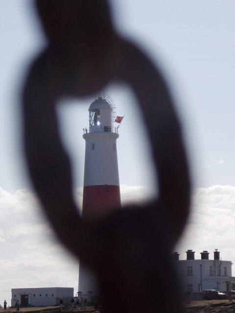 Bill of Portland: the lighthouse through a chain link