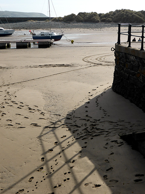 Footprints in the sand by Barmouth Harbour