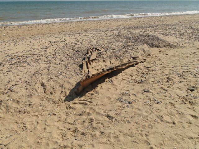 Boat buried in the sand on Covehithe beach