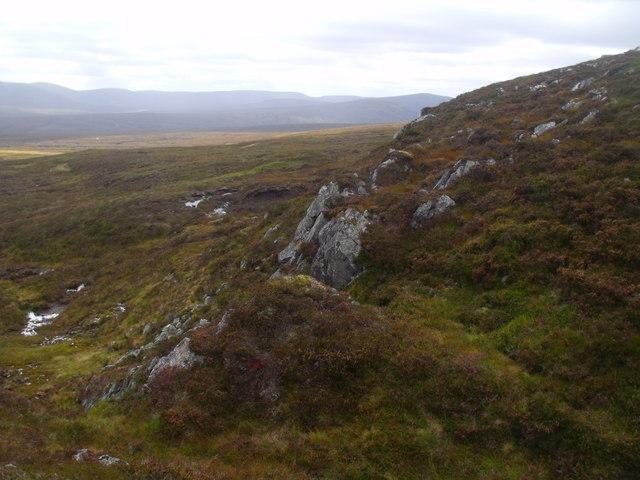 Broken rocky ground above flat peat land west of River Eidart, Glenfeshie