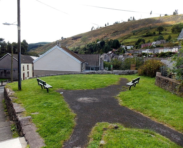Benches alongside a path in Pontycymer