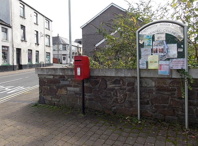 Community noticeboard and postbox in Pontycymer