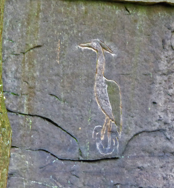 Heron carved on the rock face