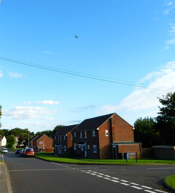 Looking along Kersley Crescent with glider above