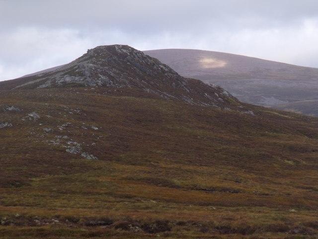 Quartzite outcrop west of River Eidart seen across the course of Allt Eindart on Glenfeshie estate