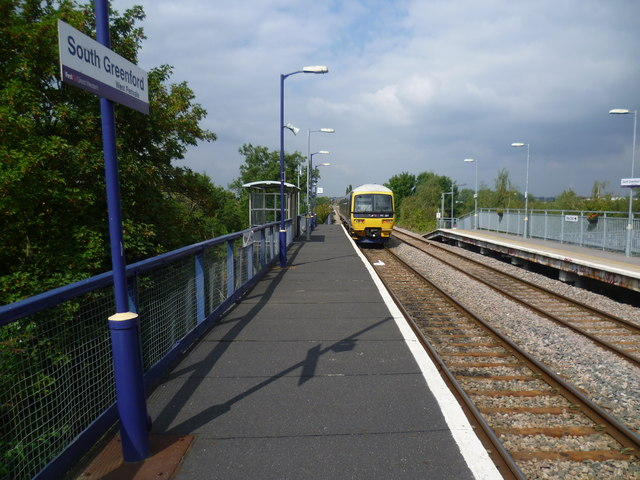 A train leaves South Greenford station