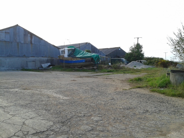 Farm buildings with a fishing boat