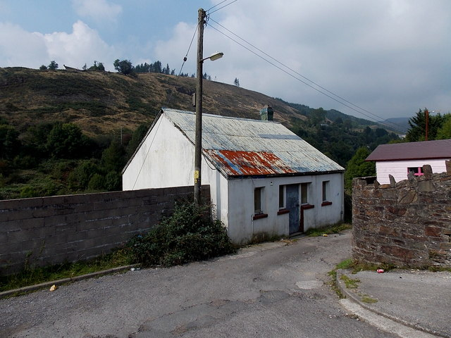 Corrugated roofed building at the edge of Blandy Park, Pontycymer