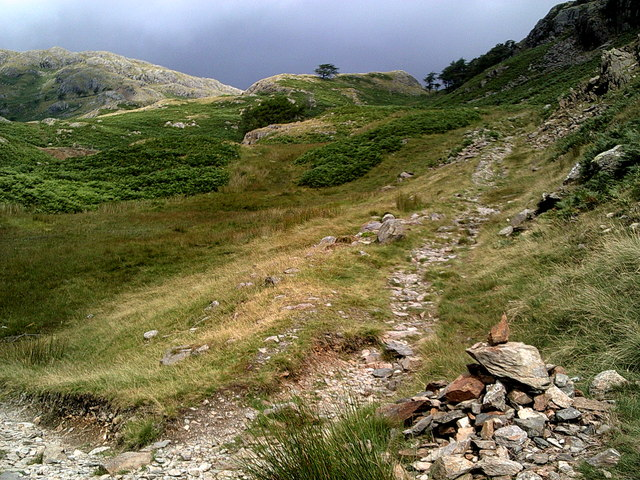 Sunshine and shade – small cairn on a path up Wetherlam