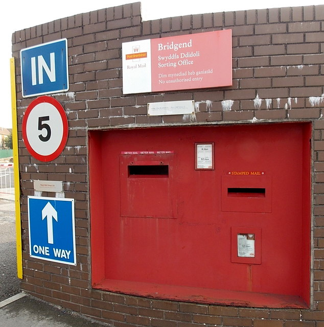 Postboxes in the wall at the entrance to Bridgend Delivery Office