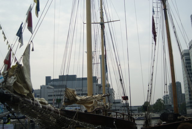 View of a mast lining up with the Baltimore Tower