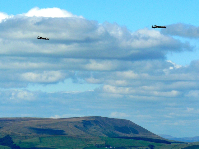 Two Lancaster Bombers fly past Pendle Hill
