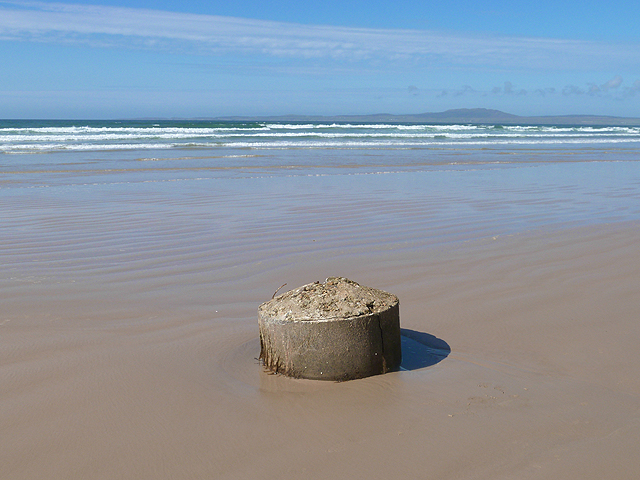 Concrete cylinder on the beach