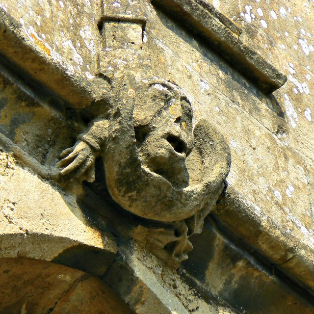 Cheeky grotesque, Church of St Cyriac, Lacock, Wiltshire