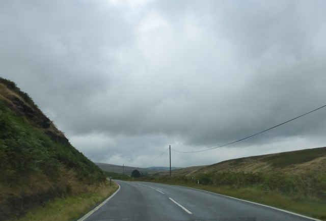 Road, tree and rainclouds on A672