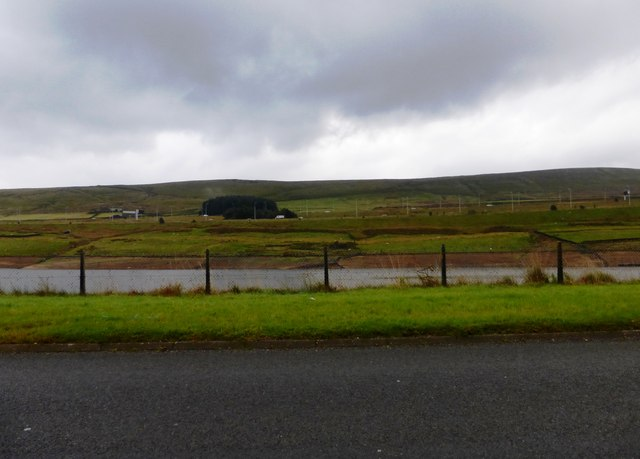 View across Booth Wood Reservoir to the M62