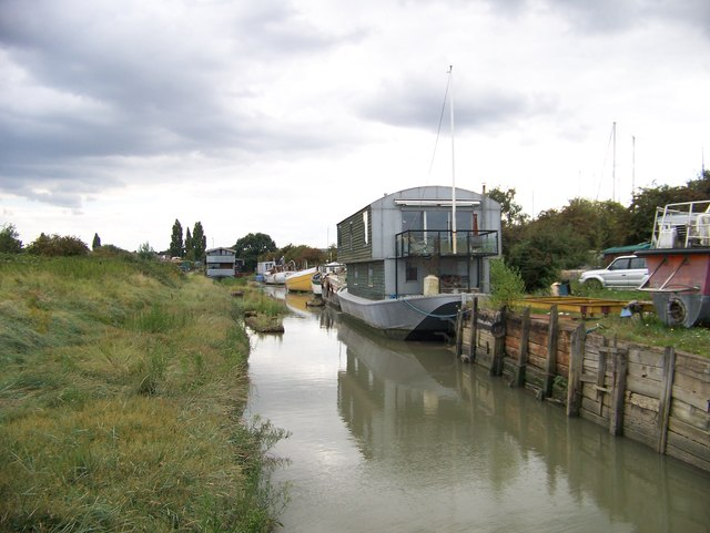Houseboats up a small inlet from the tidal Faversham Creek