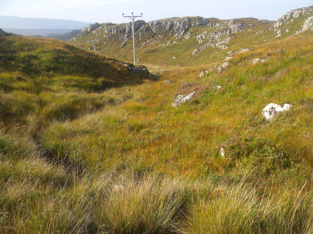 Power line in burn course north of Black Loch near Lochinver