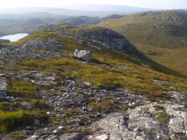 Rock ridge above Black Loch near Lochinver