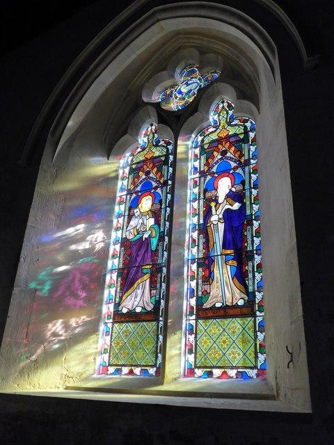 Saint George, Trotton: a sun dappled stained glass window