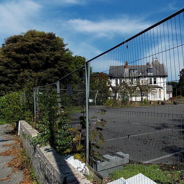 Fenced-off former County Hotel in Alderley Edge