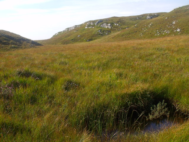 Hidden stream in peat below Cnoc Breac near Lochinver